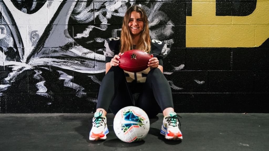 Vanderbilt soccer player Sarah Fuller holds a football as she is set to become the first Power 5 Conference female kicker for the Commodores against the Missouri Tigers