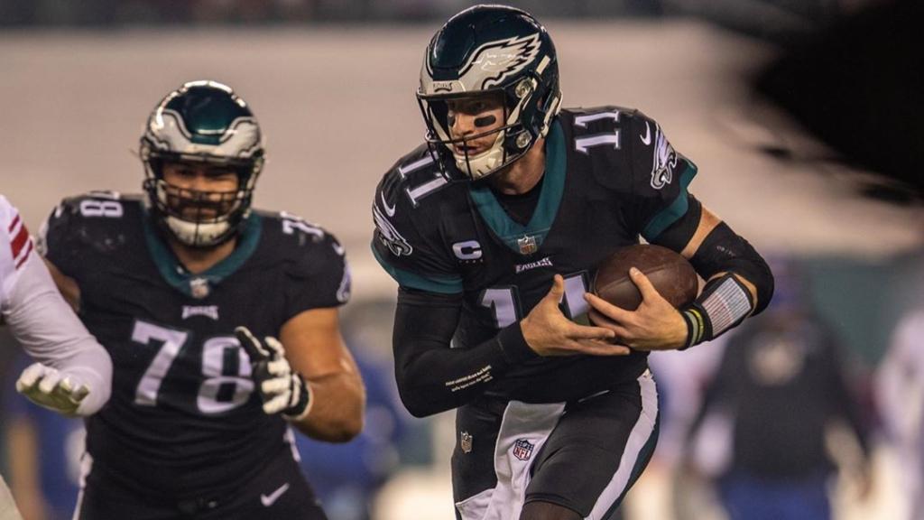 Philadelphia Eagles quarterback Carson Wentz carries the football against the New York Giants on Thursday Night Football