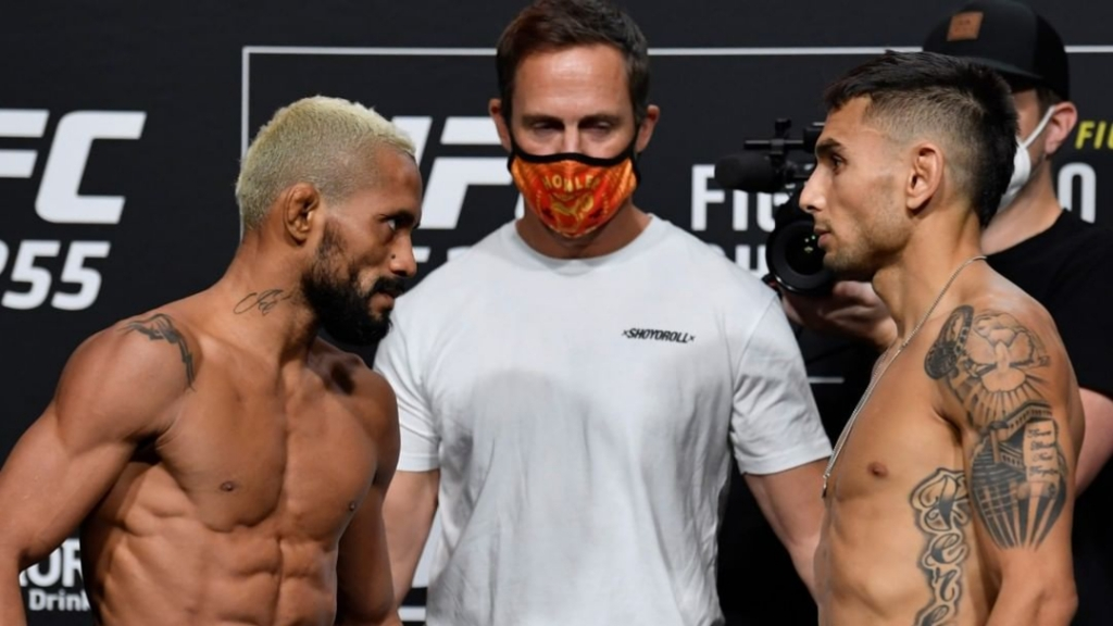 UFC Flyweight Champion Deiveson Figueiredo goes face-to-face with challenger Alex Perez following weigh-in before UFC 255