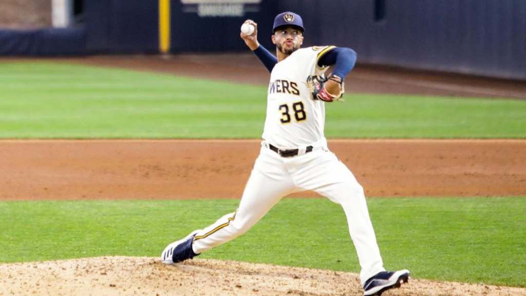 Milwaukee Brewers pitcher Devin Williams throws a pitch in an MLB game