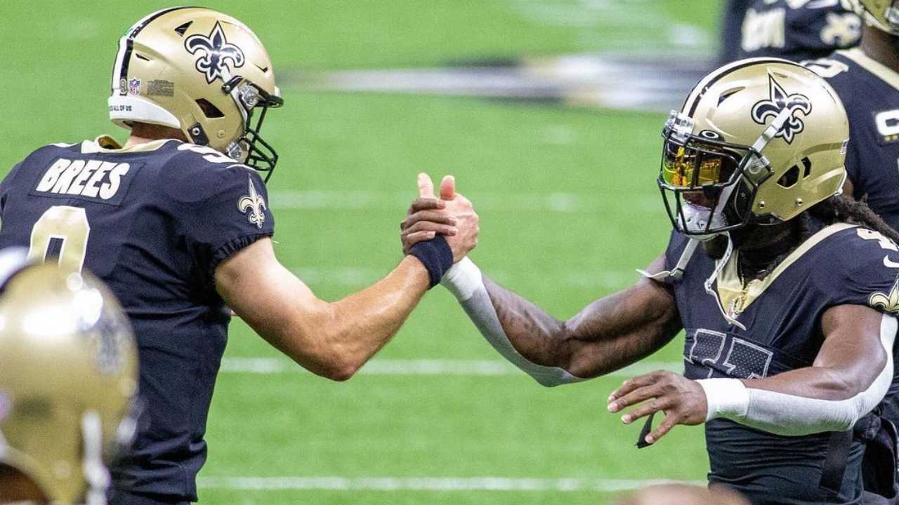 New Orleans Saints quarterback Drew Brees gives dap to running back Alvin Kamara before their team takes on the San Francisco 49ers