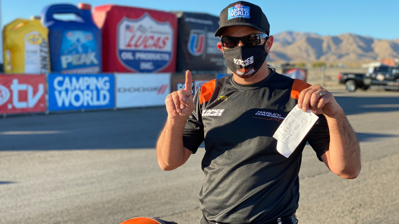 Vance & Hines Harley-Davidson Pro Stock Motorcycle rider Eddie Krawiec celebrates his No. 1 qualifier on Saturday at the 20th annual Dodge NHRA Finals presented by Pennzoil