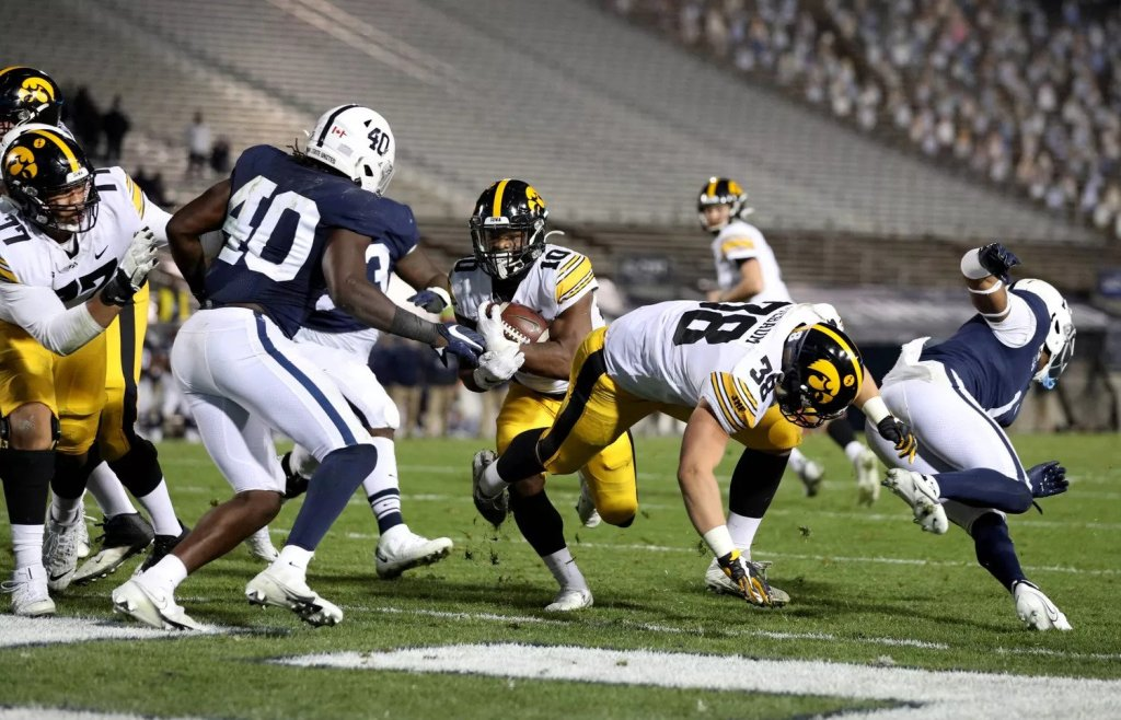 Iowa Hawkeyes running back Mekhi Sargent scoring a rushing touchdown against the Penn State Nittany Lions