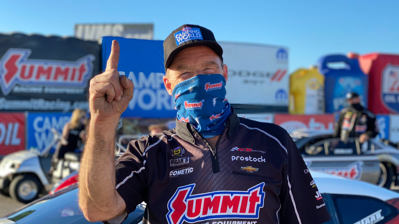Summit Racing Equipment-sponsored Pro Stock driver Greg Anderson celebrates his No. 1 qualifier on Saturday at the 20th annual Dodge NHRA Finals presented by Pennzoil