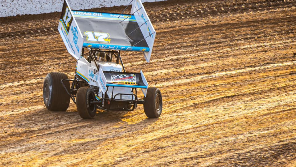 Sprint Car driver Harli White competing in a Sprint Car race in her family operation