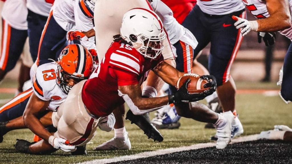 Louisville Cardinals running back Jalen Mitchell scores a touchdown against the Syracuse Orange