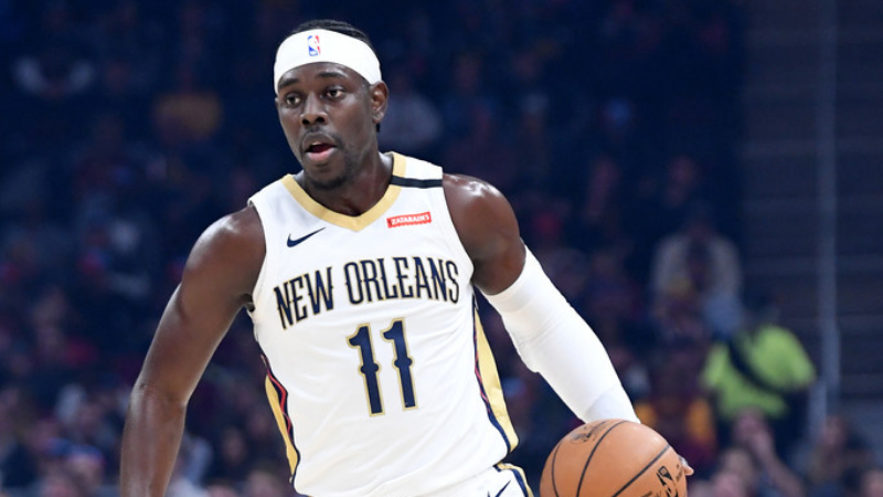 New Orleans Pelicans guard Jrue Holiday drives down court against the Cleveland Cavaliers
