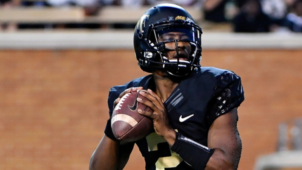 Former Wake Forest Demon Deacons quarterback Kendall Hinton drops back to pass the football against the Presbyterian Blue Hose