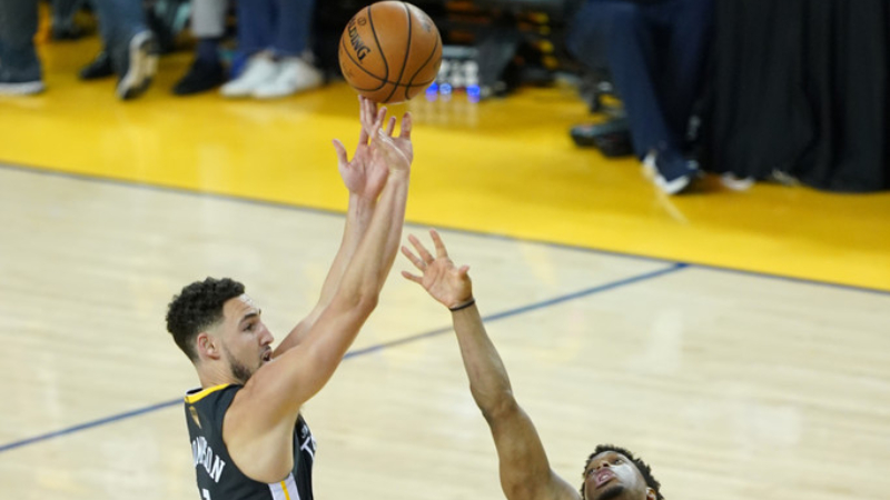 Golden State Warriors forward Klay Thompson attempts a jump shot against the Toronto Raptors in the second half during Game Six of the 2019 NBA Finals
