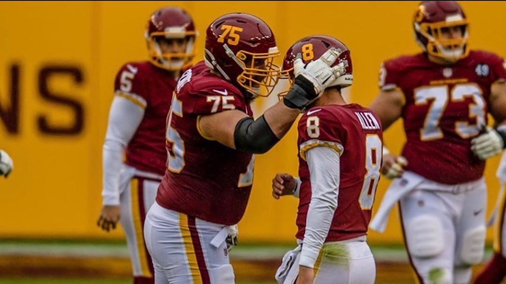 Washington Football Team quarterback Kyle Allen celebrates with offensive lineman Brandon Scherff after a play against the Dallas Cowboys
