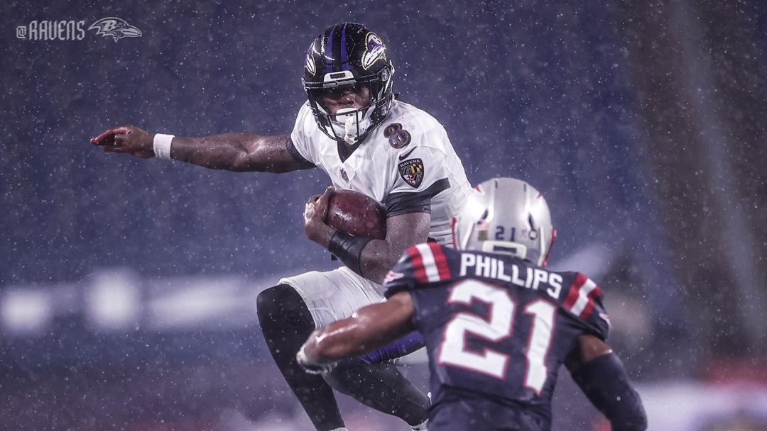 Baltimore Ravens quarterback Lamar Jackson carries the football against the New England Patriots