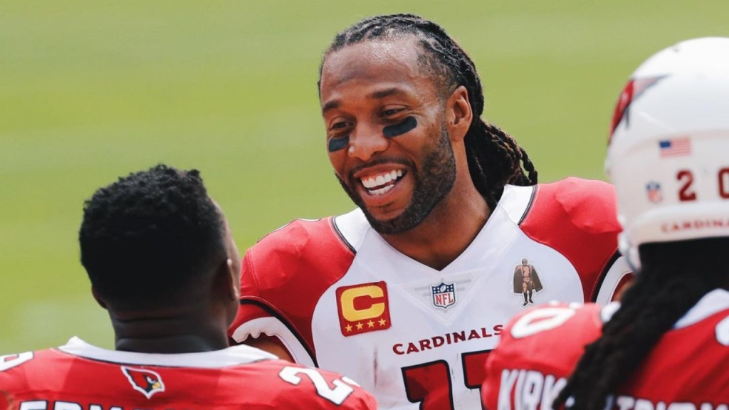 Arizona Cardinals wide receiver Larry Fitzgerald talks to his teammate during a break in action, as his team takes on the San Francisco 49ers