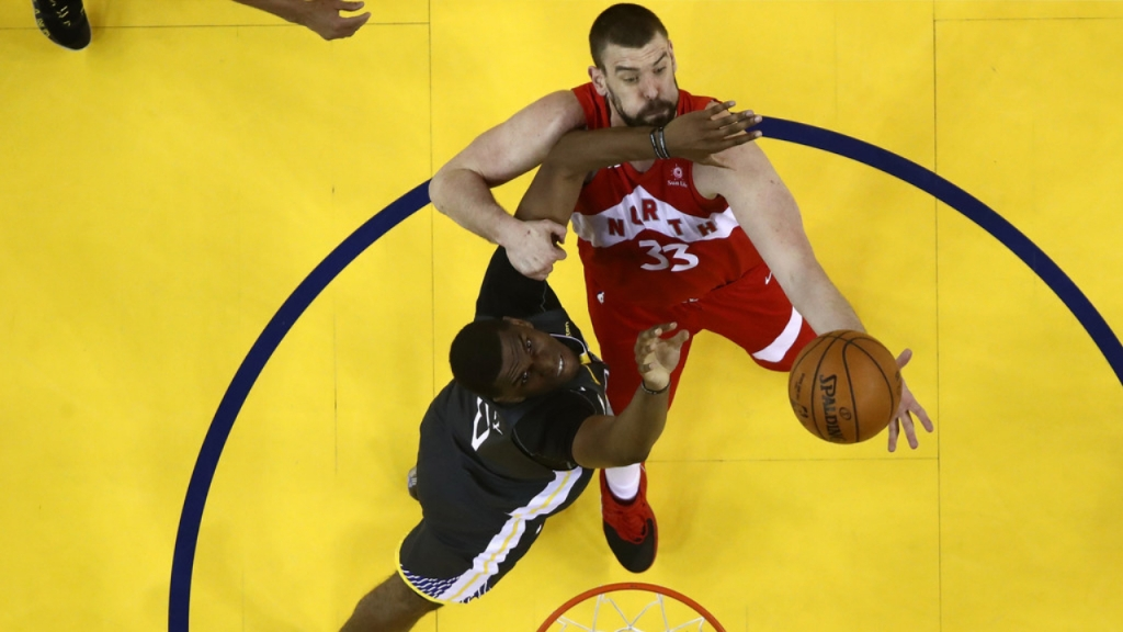 Toronto Raptors center Marc Gasol battles for a rebound with Kevon Looney against the Golden State Warriors in Game Four of the 2019 NBA Finals