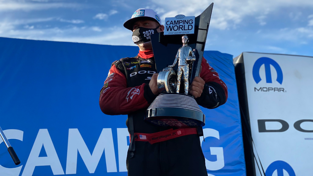 Don Schumacher Racing Funny Car pilot Matt Hagan celebrates with his 2020 Championship Wally at the 20th annual Dodge NHRA Finals presented by Pennzoil