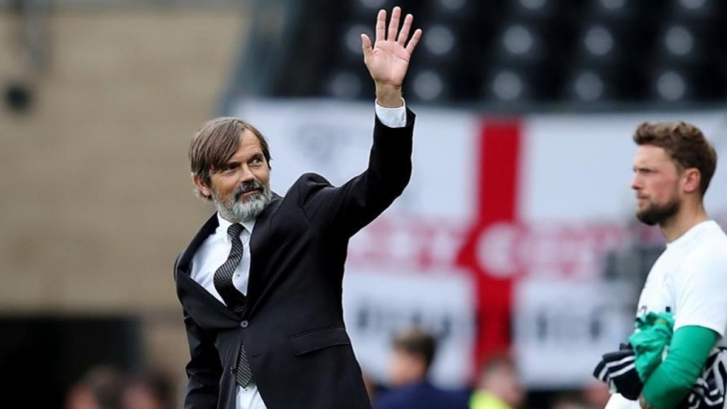 Derby County F.C. Manager Phillip Cocu waves to the crowd following a game