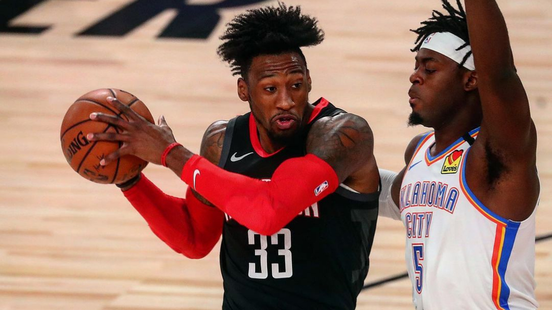 Houston Rockets forward/center Robert Covington drives to the basket as Luguentz Dort defends him against the Oklahoma City Thunder