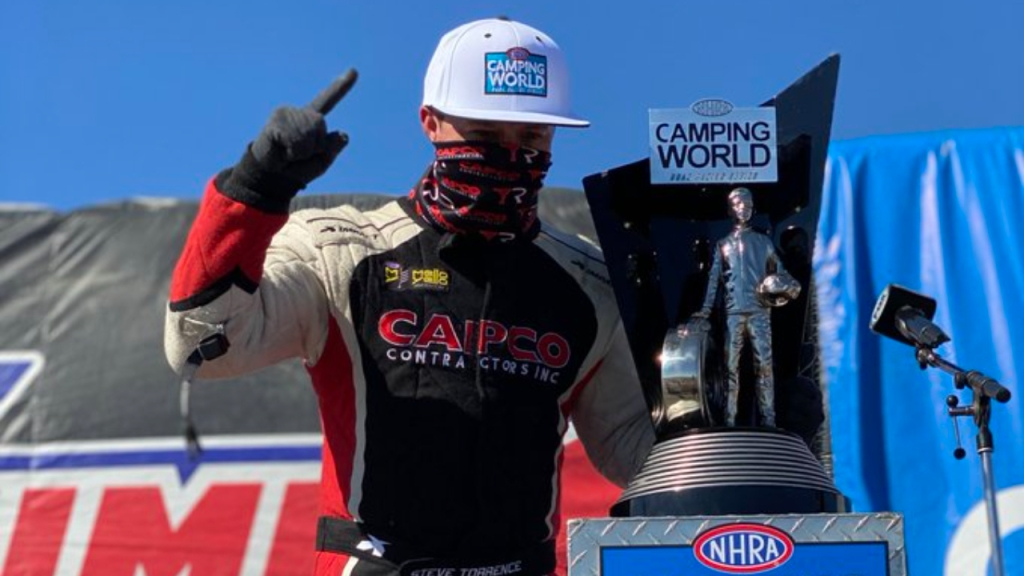 Capco Contractors Top Fuel Dragster pilot Steve Torrence celebrates with his 2020 Championship Wally at the 20th annual Dodge NHRA Finals presented by Pennzoil