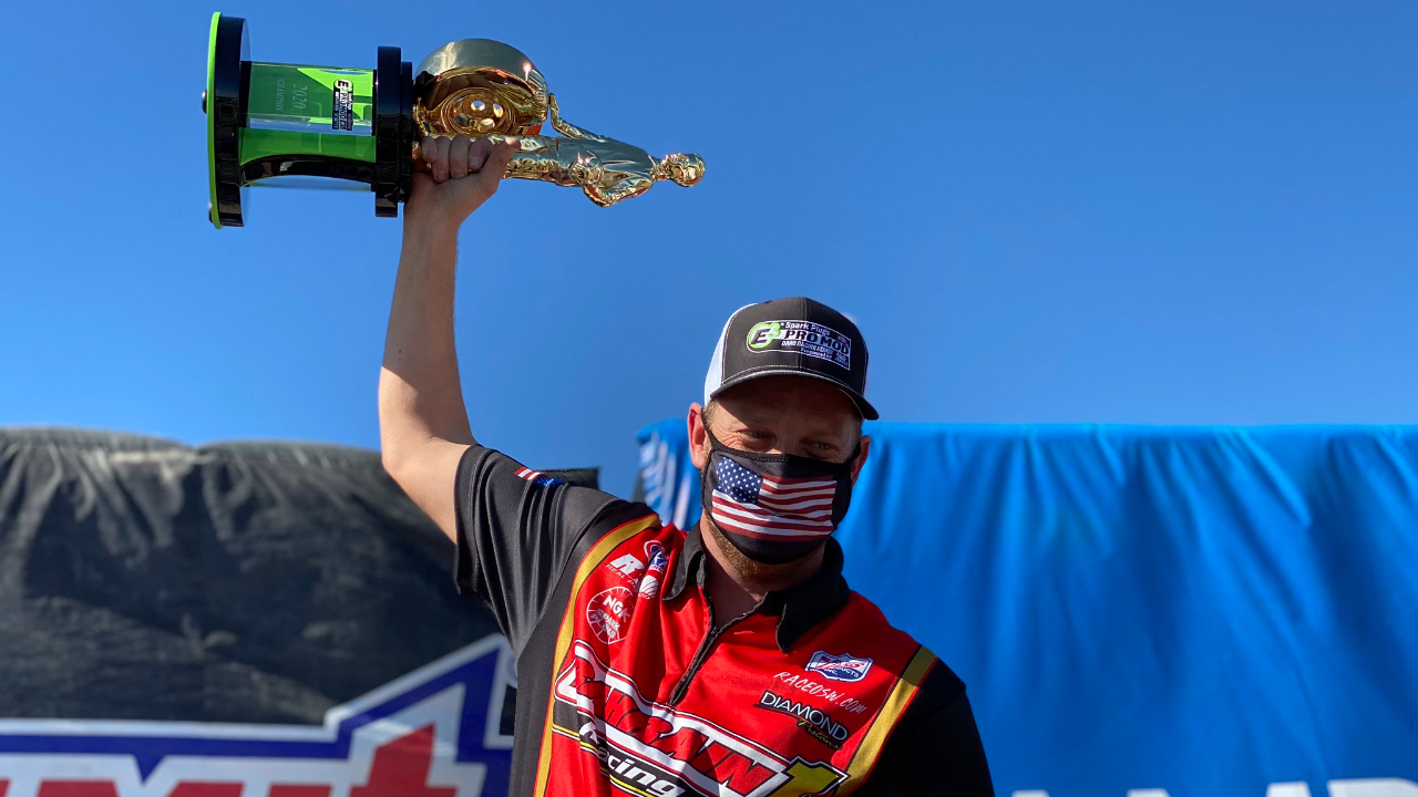 """Bahrain 1 Pro Mod driver Steve """"Stevie Fast"""" Jackson celebrates with his 2020 Championship Wally at the 20th annual Dodge NHRA Finals presented by Pennzoil"""