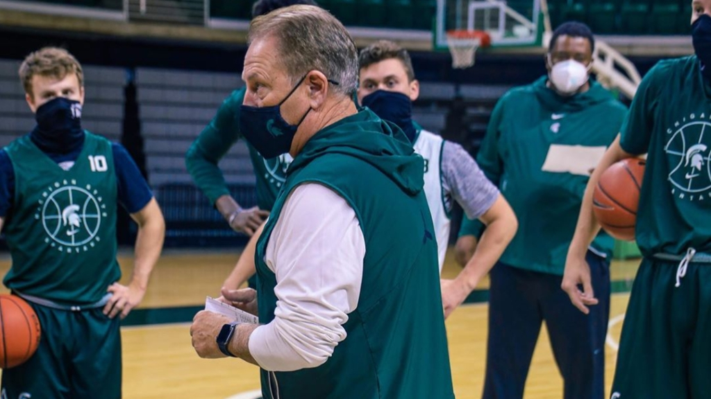 Tom Izzo talks to his players at practice as his team amps up for the upcoming 2020-21 season