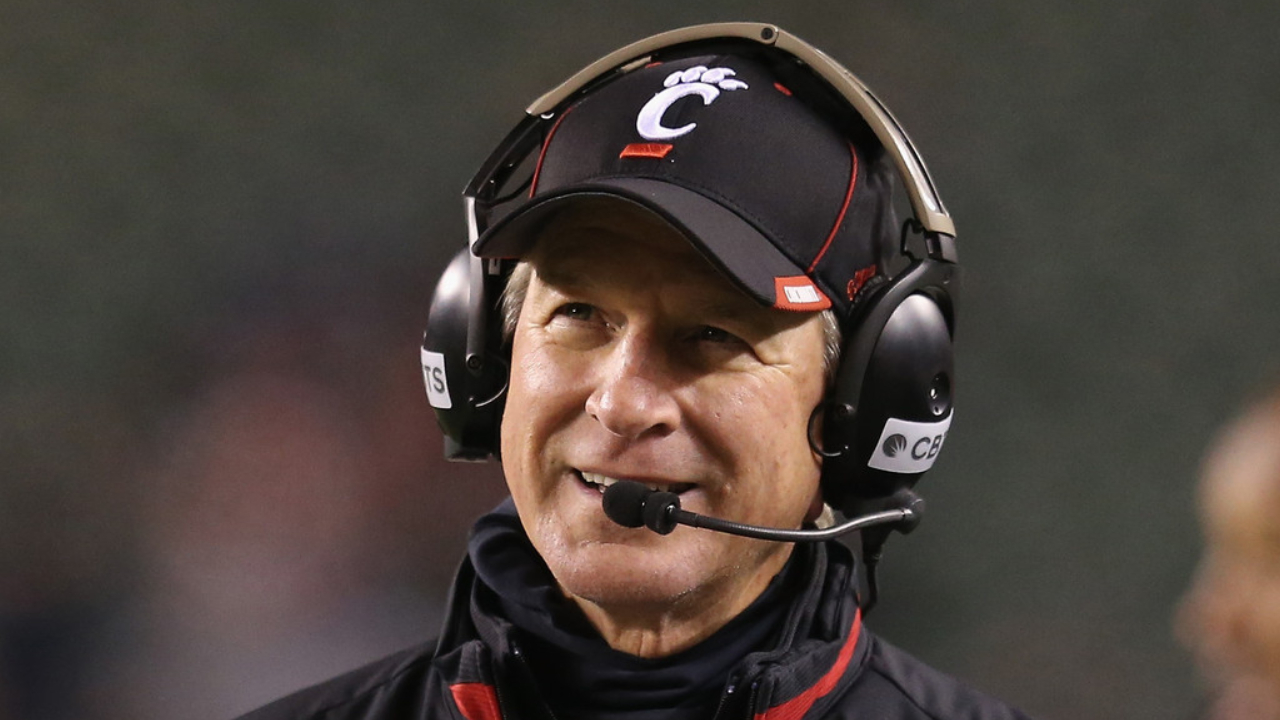 Former Cincinnati Bearcats head coach Tommy Tuberville watches the action against the East Carolina Pirates