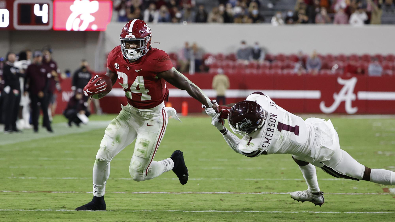 Alabama Crimson Tide running back Trey Sanders carries the ball against the Mississippi State Bulldogs