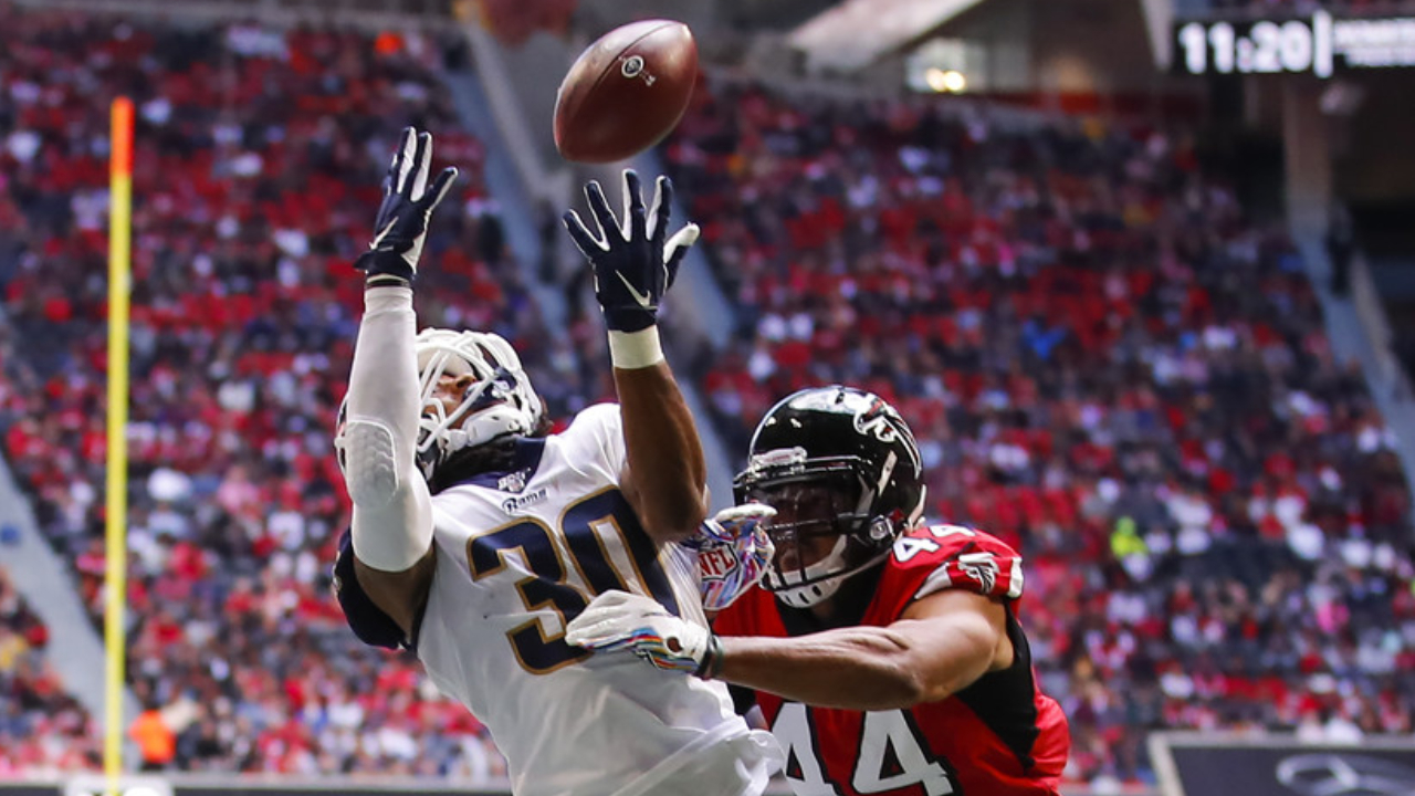 Former Atlanta Falcons linebacker Vic Beasley attempts to tackle Todd Gurley II against the Los Angeles Rams