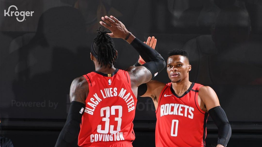 Houston Rockets point guard Russell Westbrook gives Robert Covington an high-five following a play against the Los Angeles Lakers in Game 2 of the Western Conference Semifinals in the 2020 NBA Playoffs