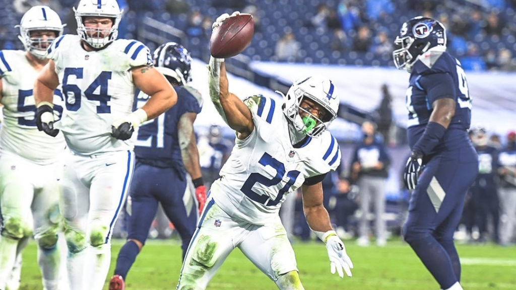 Indianapolis Colts running back Nyheim Hines spikes the football after scoring a touchdown against the Tennessee Titans