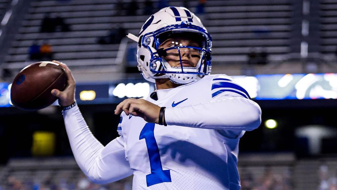 BYU Cougars quarterback Zach Wilson warms up before his team did battle with the Boise State Broncos