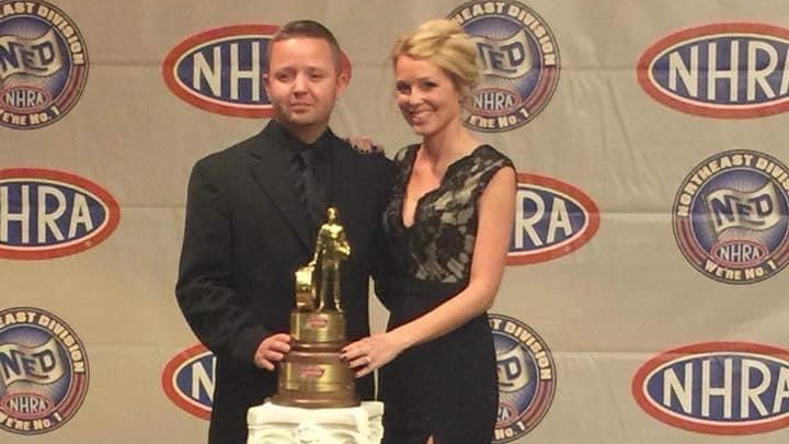 Soon-to-be Top Fuel Dragster competitor Josh Hart and his wife Brittanie Hart stand with a Lucas Oil Trophy at the NHRA Northeast Division Awards