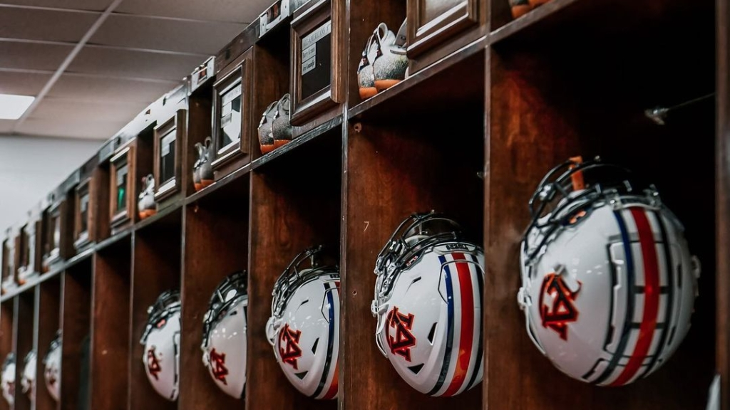 Auburn football helmets in the dressing room