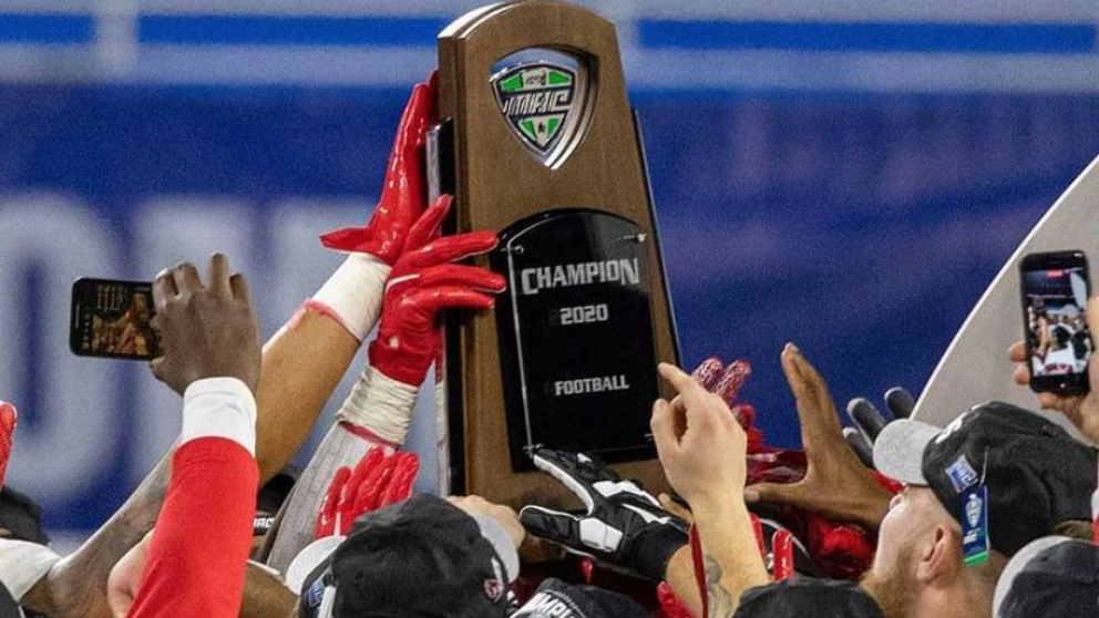 Ball State Cardinals players celebrate their win with the MAC Championship trophy after defeating the Buffalo Bulls