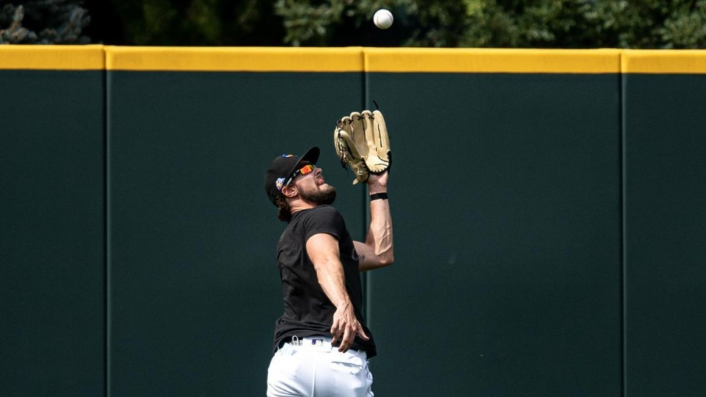Former Colorado Rockies outfielder David Dahl shags a fly ball during batting practice