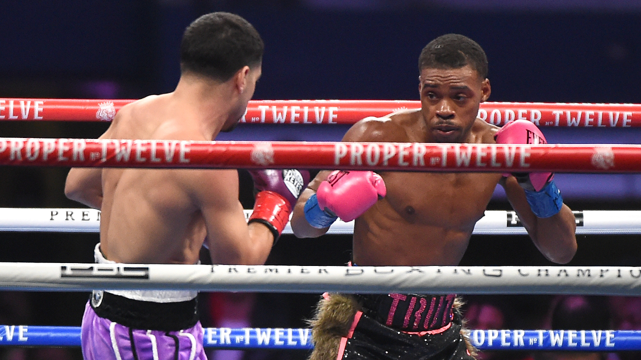 Boxing Champion Errol Spence Jr. attempts to punch Danny Garcia during their title fight on Fox Sports Premier Boxing Championship Pay-Per-View fight night