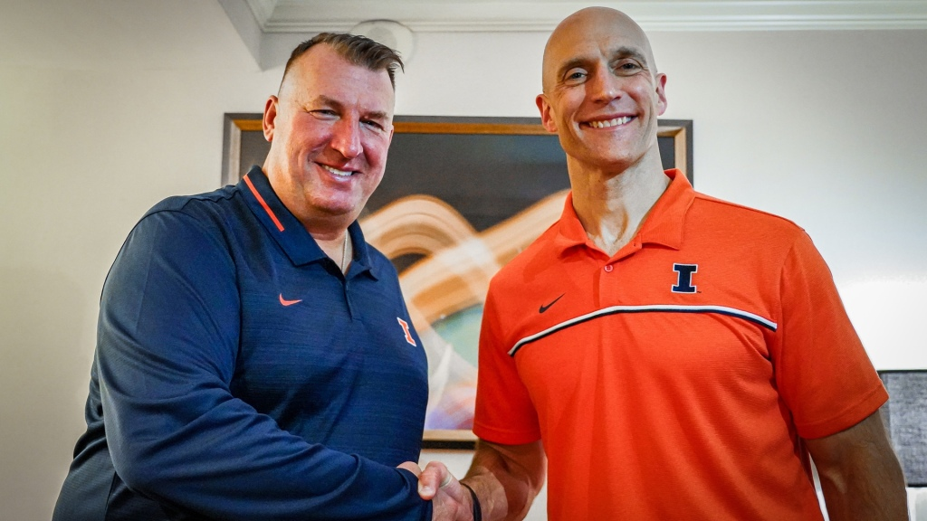New Illinois Fighting Illini football coach Bret Bielema stands next to Athletic Director Josh Whitman