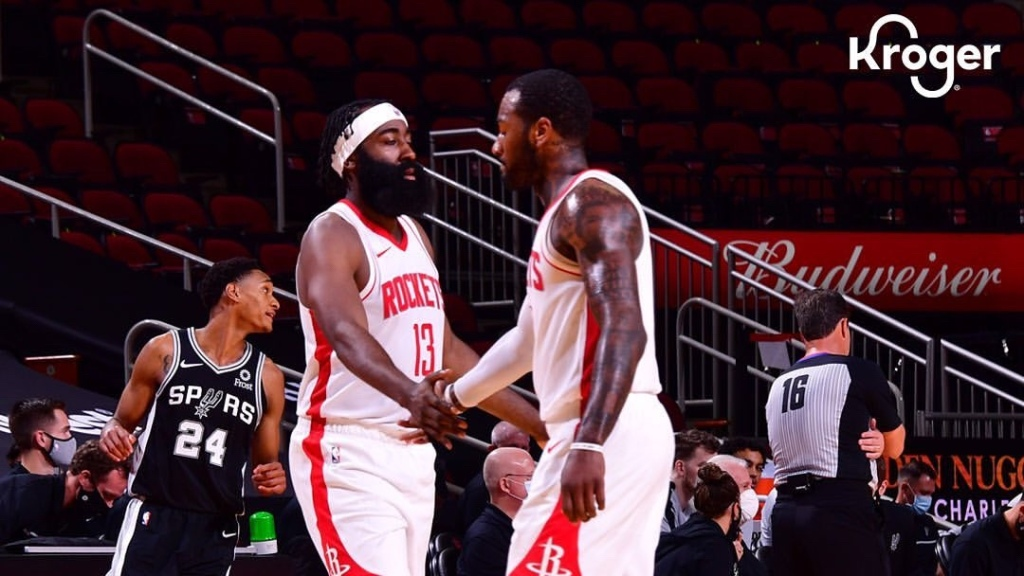 Houston Rockets superstar James Harden daps John Wall following a stoppage in play against the San Antonio Spurs