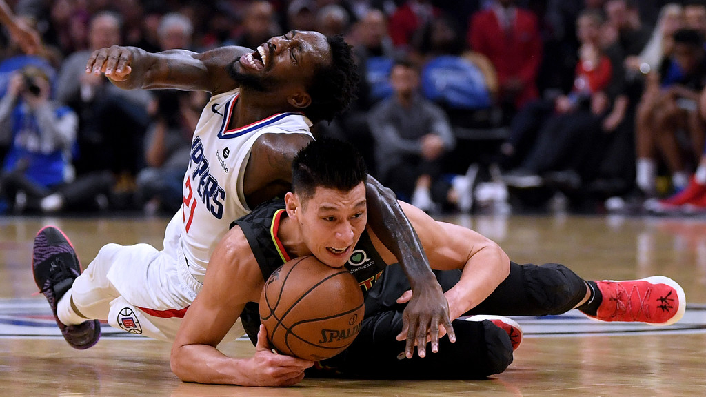 Former Atlanta Hawks player Jeremy Lin protects the ball from Patrick Beverley against the Los Angeles Clippers