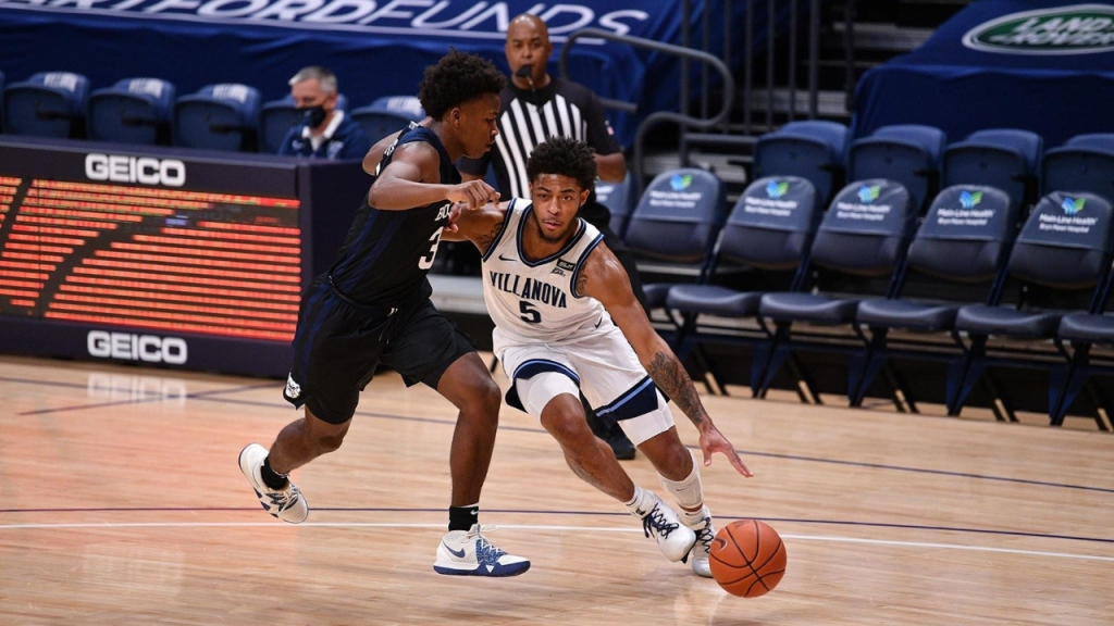 Villanova Wildcats guard Justin Moore drives to the basket against the Butler Bulldogs