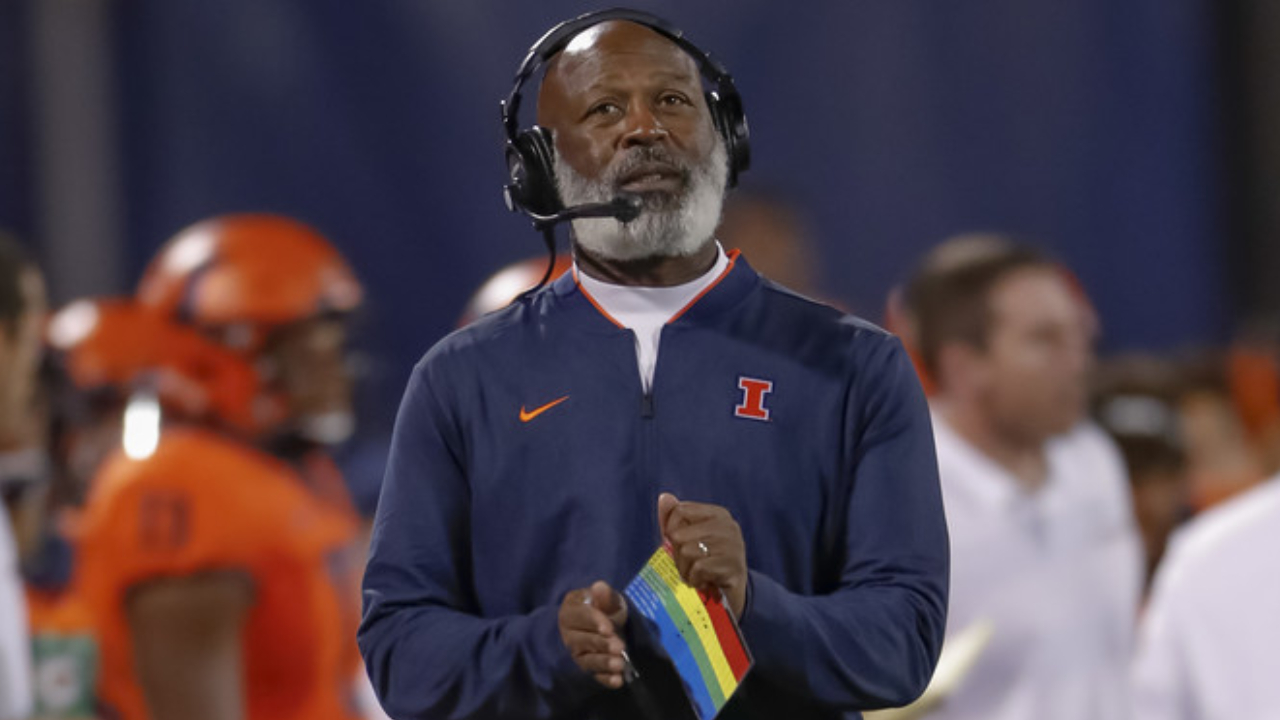 Former Illinois head football coach Lovie Smith looks up at the clock against the Penn State Nittany Lions