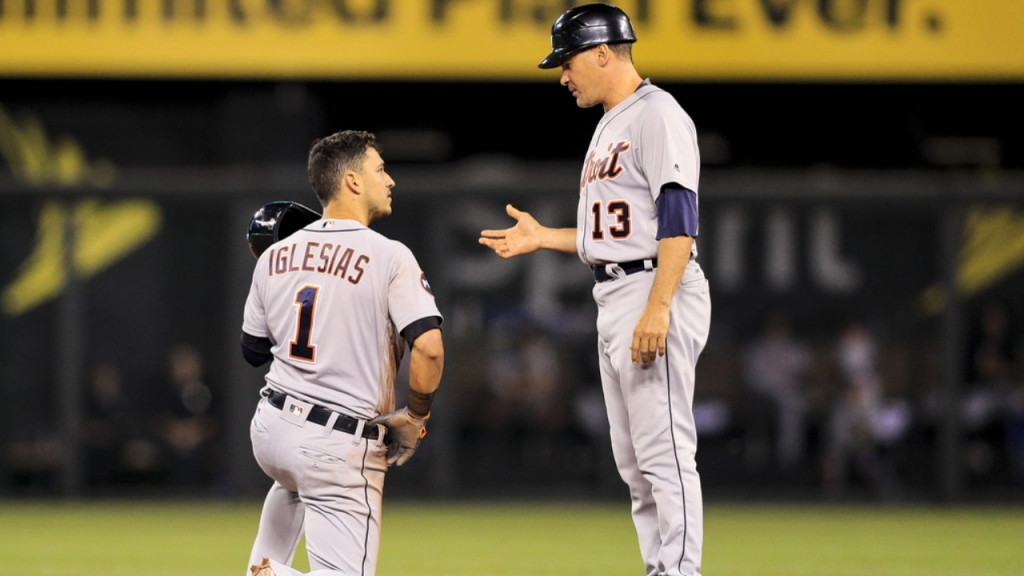 Former Detroit Tigers first base coach Omar Vizquel speaks with José Iglesias after he was picked off by the Kansas City Royals