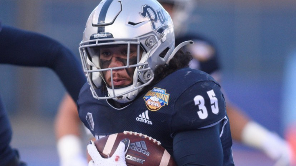 Nevada Wolf Pack running back Toa Taua carries the football against the Tulane Green Wave in the Famous Idaho Potato Bowl