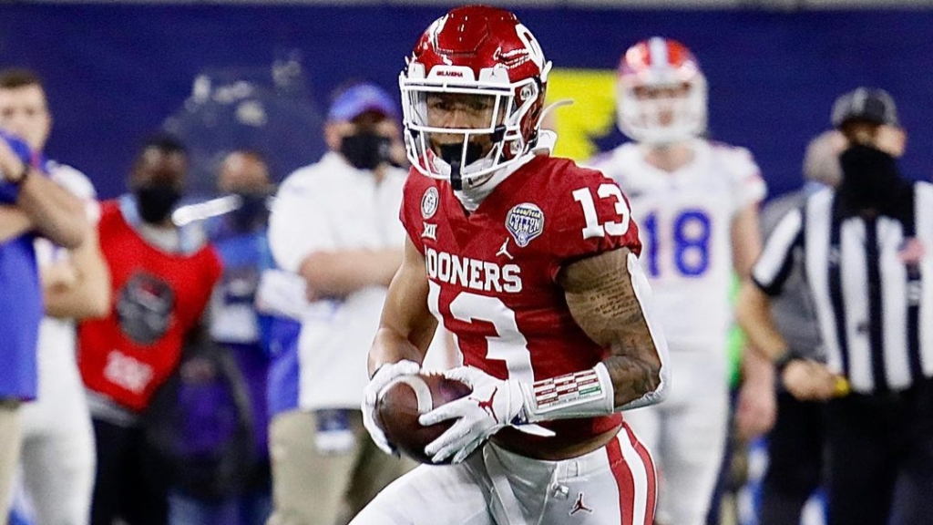 Oklahoma Sooners defensive back Tre Norwood picks off Kyle Trask against the Florida Gators in the Goodyear Cotton Bowl Classic