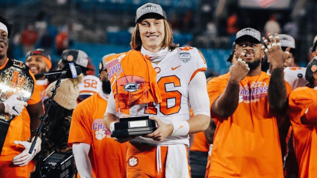 Clemson Tigers quarterback Trevor Lawrence celebrates after being named the MVP of the 2020 Atlantic Coast Conference Championship game against the Notre Dame Fighting Irish