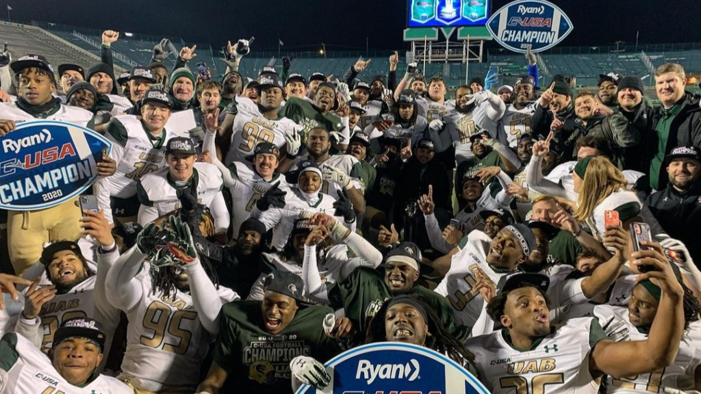 UAB Blazers players, coaches, and administration celebrate their second Conference USA Championship over the Marshall Thundering Herd