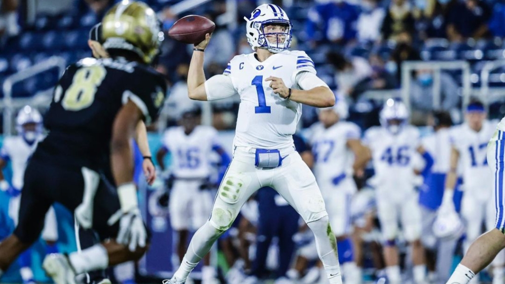 BYU Cougars quarterback Zach Wilson attempts a pass against the UCF Knights in the 2020 Roofclaims.com Boca Raton Bowl