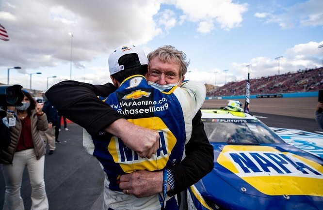 NAPA Auto Parts NASCAR Cup Series driver Chase Elliott celebrates his 2020 NASCAR Cup Series Championship with his father and former Cup Series driver Bill Elliott at the Season Finale 500