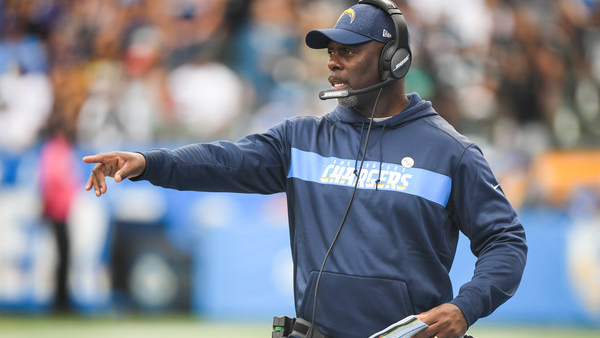 Former Los Angeles Chargers head coach Anthony Lynn motions to his players against the Oakland Raiders