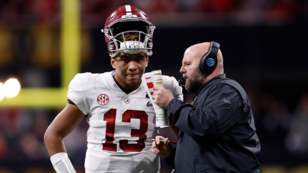 Former Alabama Crimson Tide offensive coordinator Brian Daboll speaks with Tua Tagovailoa against the Georgia Bulldogs in the College Football Playoff National Championship presented by AT&T