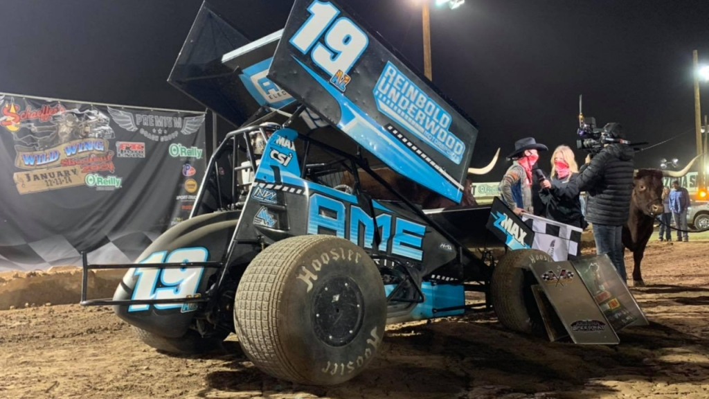 """AME Electrical Sprint Car driver Michael """"Buddy"""" Kofoid does an interview after winning the first round of the Wild Wing Shootout"""