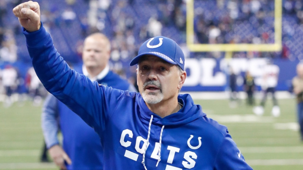 Former Indianapolis Colts head coach Chuck Pagano raises his fist to the crowd following a win over the Houston Texans